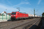 BR 185 191-4 pulls tankers through Nauheim towards Mainz on 09 May 2016.