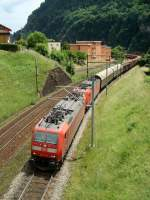 Two BR 185 with the red train below Faido, 07.06.2008